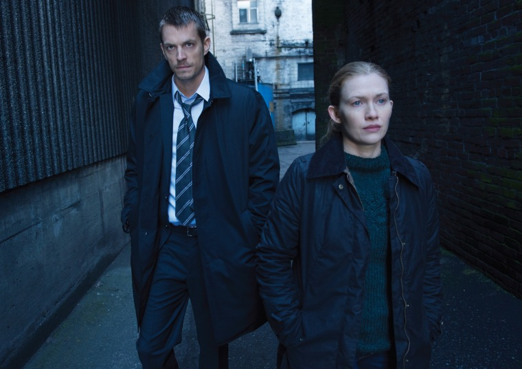 "Stephen Holder (Joel Kinnaman) and Sarah Linden (Mireille Enos) in ""The Killing."""
