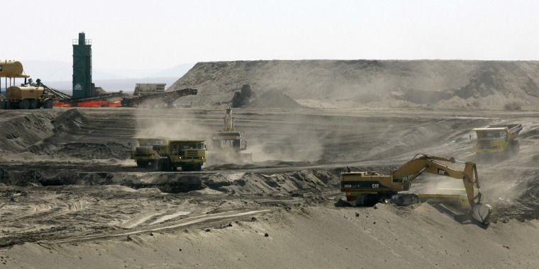 This April 3, 2008, photo shows workers using heavy equipment to bury contaminated debris in a landfill on the Hanford Nuclear Reservation,near Richland, Wash.