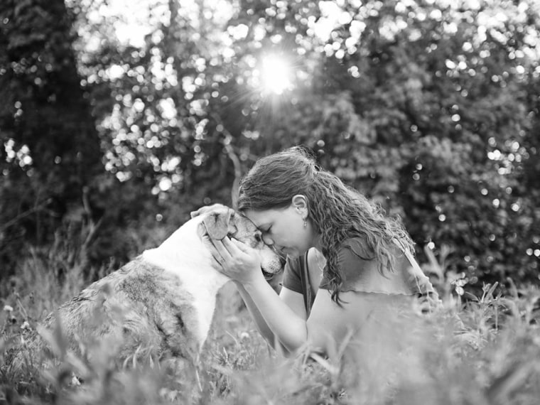 """Minnesota-based photographer Sarah Ernhart is the creator of the \""""Joy Session,'' a photo shoot capturing the bond between owners and their terminally ill pets."""