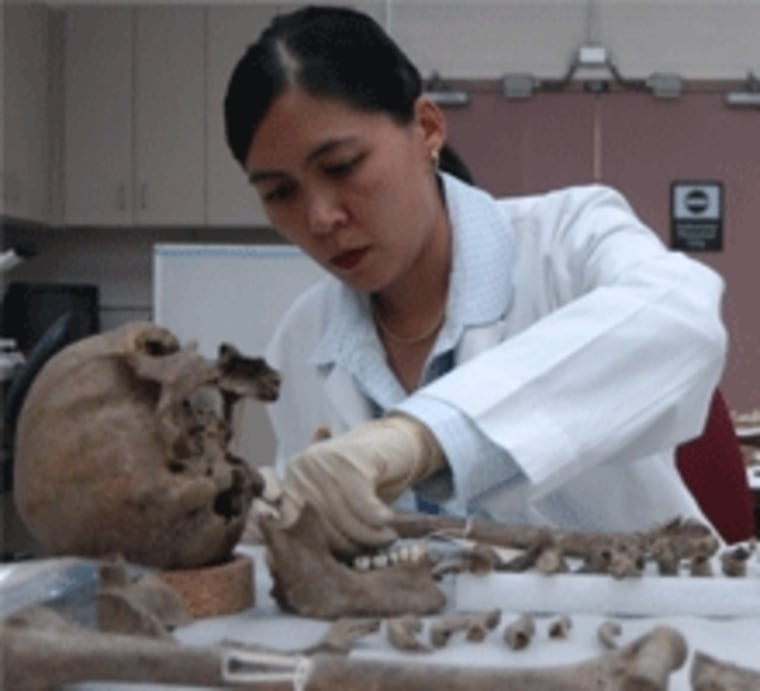An unidentified anthropologist examines human remains in the JPAC Central Identification Lab at Joint Base Pearl Harbor-Hickam in Hawaii.