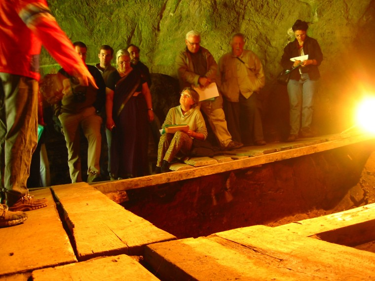 This Aug. 2005 photo provided by the journal Nature shows participants in an archaeological conference inside of Denisova cave in Altai Mountains of s...