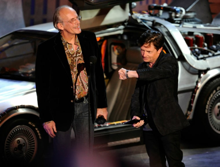 """Christopher Lloyd and Michael J. Fox accept an award during Spike TV's """"Scream 2010"""" event in L.A."""