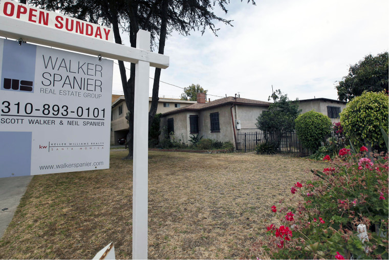 In this Tuesday, June 11, 2013, photo, a single house is offered for sale in Santa Monica, Calif. Sandard & Poor's/Case-Shiller reports on home price...