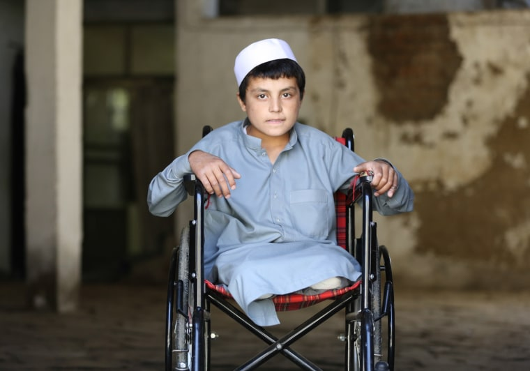 Twelve-year-old Obaidullah Salaar sits in a wheelchair at his uncle's house in Kabul, Afghanistan, on Nov. 17, after he was discharged from the hospital. He lost both legs when mortars fell on his house in the village of Ghani Khail in Wardak province in eastern Afghanistan on Oct. 30, 2013. His brother, sister, cousin and uncle were also killed in the attack.