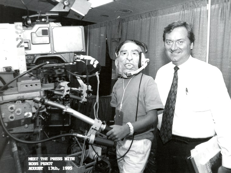 Luke Russert dresses up as Ross Perot while on the set of Meet the Press on Aug. 13, 1995.