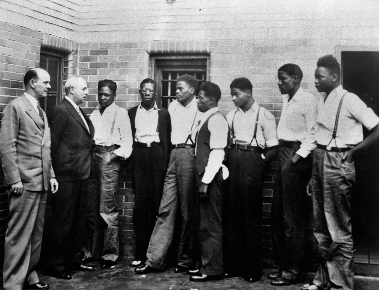 In this May 1, 1935 file photo, attorney Samuel Leibowitz, second left, meets with seven of the Scottsboro defendants at the jail in Scottsboro, Ala. just after he asked the governor to pardon the nine youths held in the case. From left are Deputy Sheriff Charles McComb, Leibowitz, and defendants, Roy Wright, Olen Montgomery, Ozie Powell, Willie Robertson, Eugene Williams, Charlie Weems, and Andy Wright. The black youths were charged with an attack on two white women on March 25, 1931.