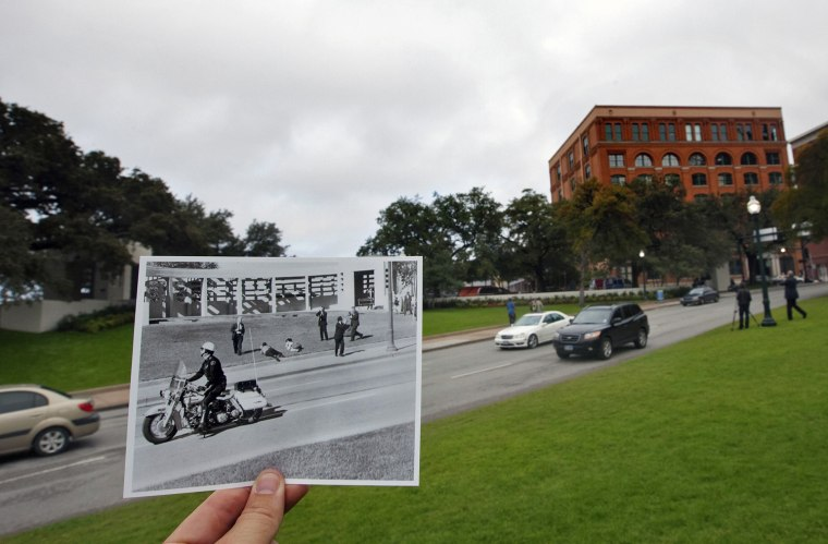 Cody Duty / Houston Chronicle Spectators Lie On The Ground In Dealey Plaza  As A Motorcycle Police Officer Drives By Immediately