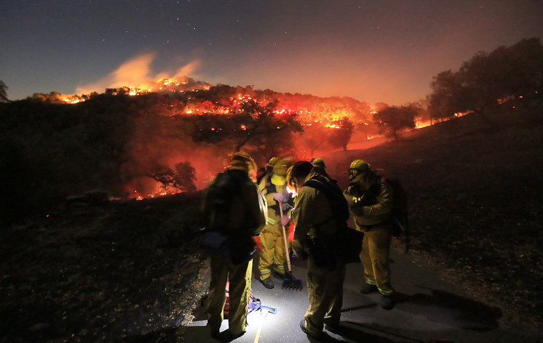 Firefighters battle unusual winter wildfire in Northern California