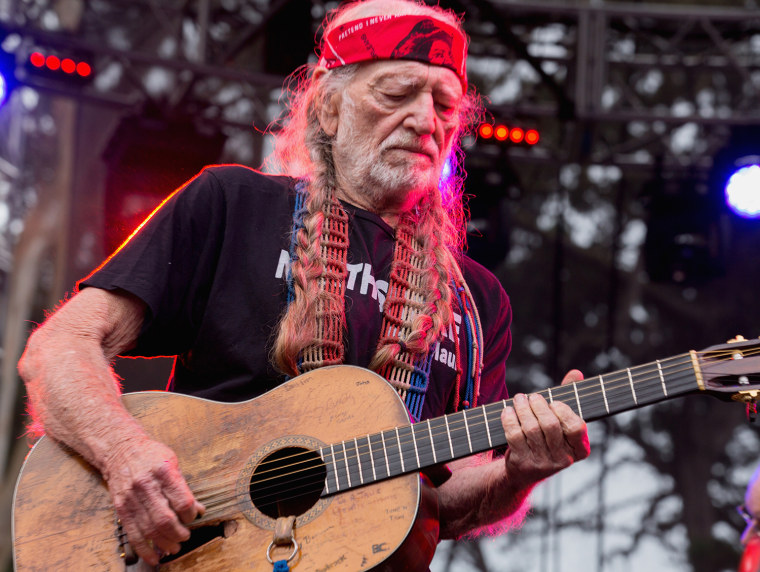 Willie Nelson performing on Aug. 11, 2013 in San Francisco. Three members of his band were injured when their tour bus crashed in Texas.