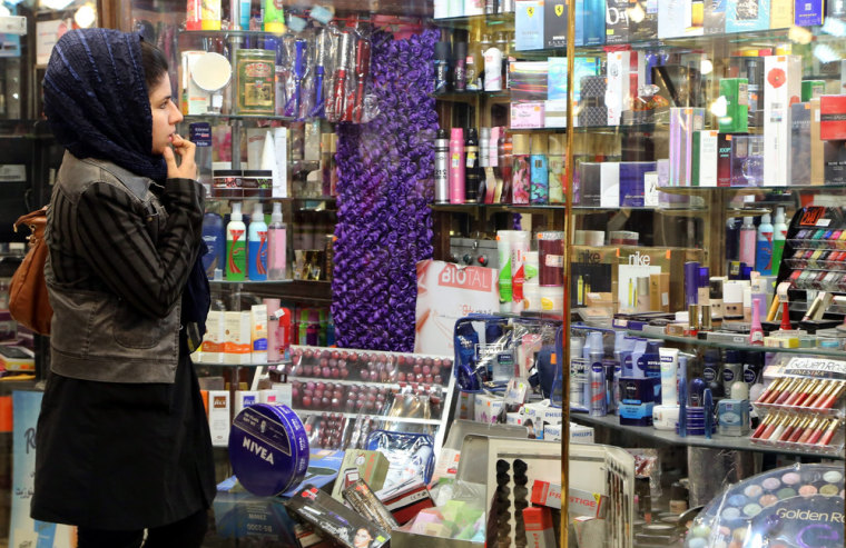 An Iranian woman window-shops at a cosmetics store in Tehran in November.