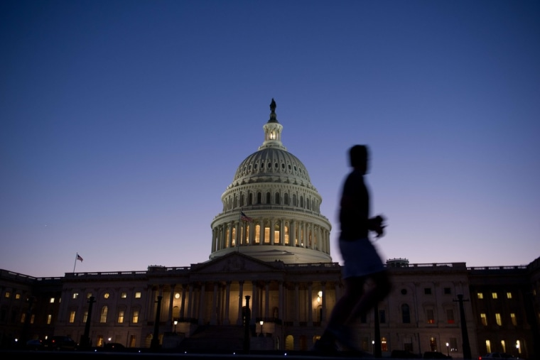 A man jogs past the US Capitol in Washington on September 30, 2013. The federal bureaucracy officially began a shutdown as of midnight, further damag...