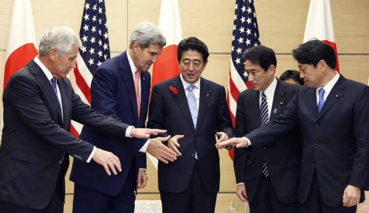 Defense Secretary Chuck Hagel (left), Secretary of State John Kerry (2nd left), Japanese Prime Minister Shinzo Abe (center), Japanese Foreign Minister Fumio Kishida (2nd right) and Japanese Defense Minister Itsunori Onodera prepare to shake hands before their meeting in Tokyo on Friday.