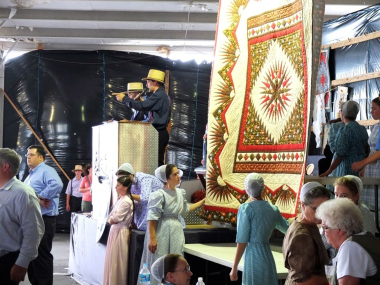 The Leola Benefit Auction, a live quilt auction, is held in Leola, Pennsylvania. Many Amish are opting out of the requirements of the Affordable Care Act.