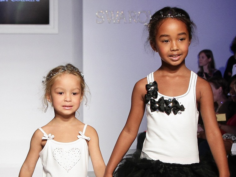 NEW YORK, NY - OCTOBER 05: Harper Tillman and Chance Combs walk the Ooh! LaLa! preview during the Swarovski at petiteParade NY Kids Fashion Week in Co...