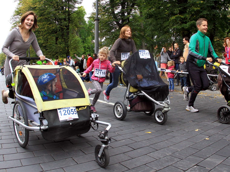 Parents push their children in prams as they participate in a 500m pram's race in Vilnius as part of the Danske Bank Vilnius Marathon event in Vilnius...