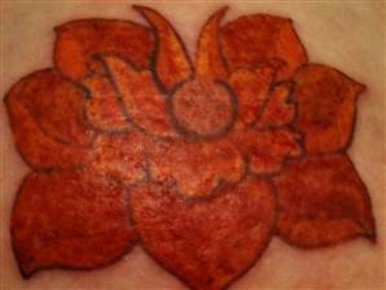Wendi Duvall lotus flower tattoo