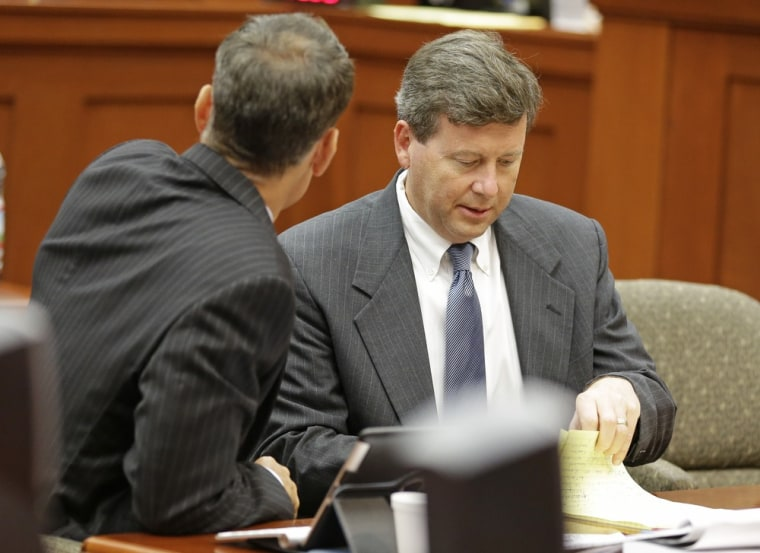 Kelly Mathis, right, in court in Sanford, Fla., during his trial last month.