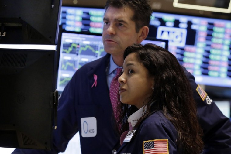 Stocks see-saw, close higher on signs of budget deal progress