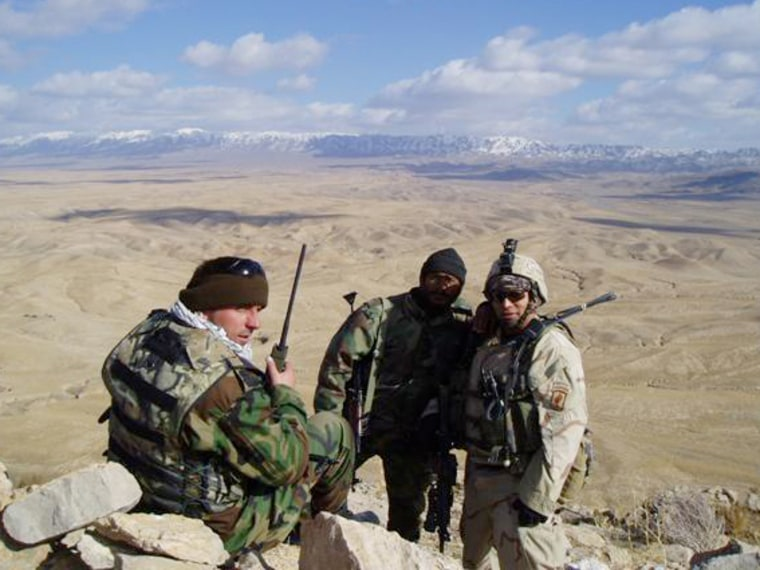 Ben Olmedo, right, a physician assistant, stands with Afghan National Army soldiers in Afghanistan. Olmedo went from Afghanistan to Alaska to start hi...