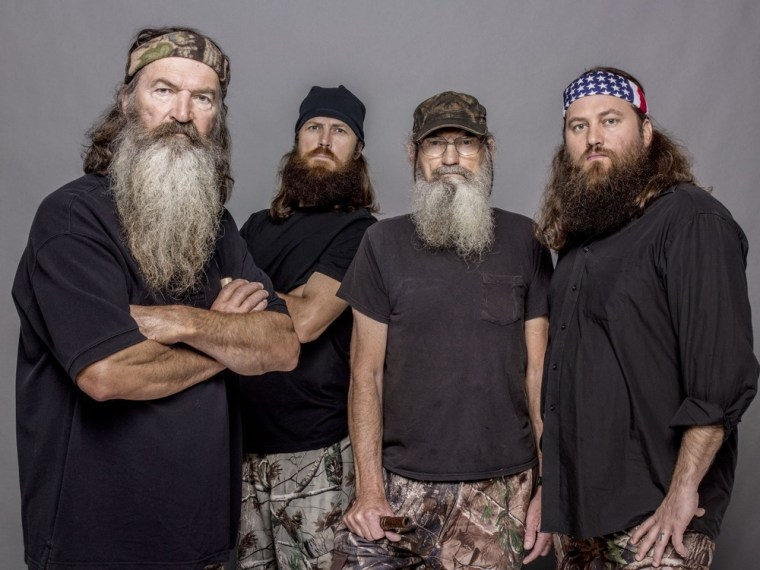 """This 2012 photo released by A&E shows, from left, Phil Robertson, Jase Robertson, Si Robertson and Willie Robertson from the A&E series, \""""Duck Dynasty.\""""  A&E says nearly 12 million viewers caught the season premiere of the hit unscripted series on Wednesday, Aug. 14, 2013."""