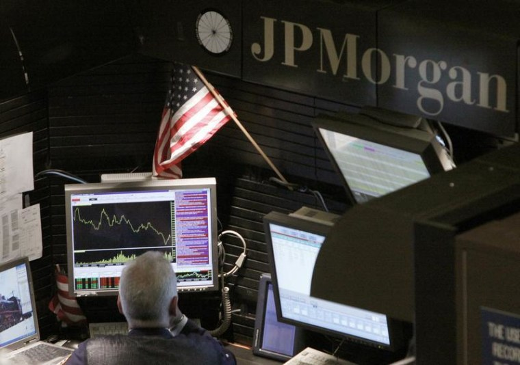A trader works in the J.P. Morgan stall on the floor of the New York Stock Exchange in this Sept. 14, 2009, file photo.