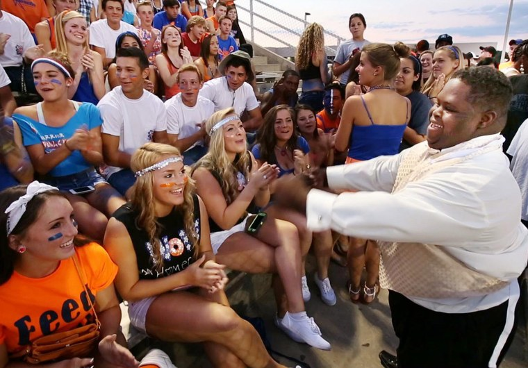 Bubba Hunter and Semone Adkins were crowned homecoming King and Queen at West Orange High School on Friday, October 11, 2013. Bubba works the audience...