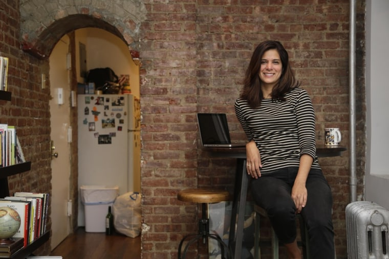 Mishelle Farer poses for a picture on Oct. 10, 2013, in her Brooklyn apartment, where she rents a room on Airbnb.