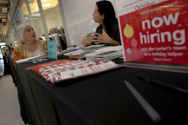 With hiring steady, but not stellar, jobless claims dropped. But a computer glitch continued to muddy the data.