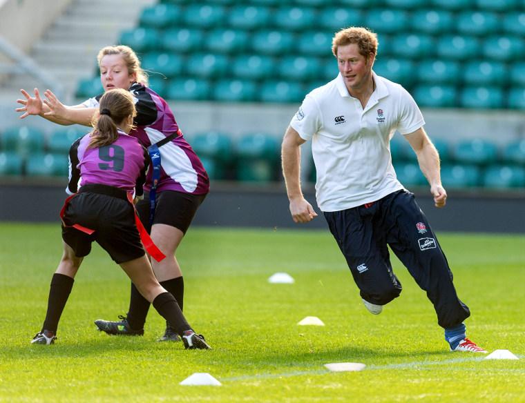 Image: Prince Harry playing football