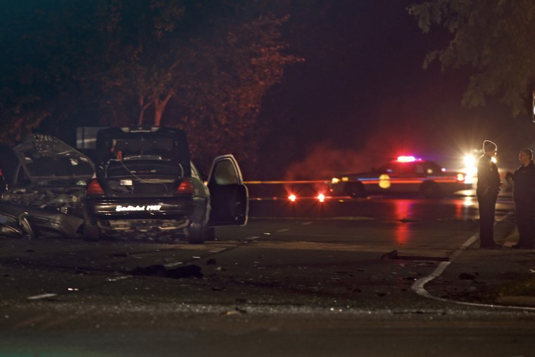 Police investigate the scene of a collision between a car and a police cruiser in Upper Arlington, Ohio, early Friday.