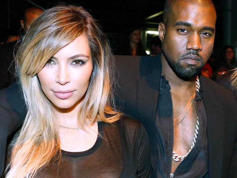 PARIS, FRANCE - SEPTEMBER 29:  Kim Kardashian, Kanye West and singer Ciara attend Givenchy show as part of the Paris Fashion Week Womenswear  Spring/S...