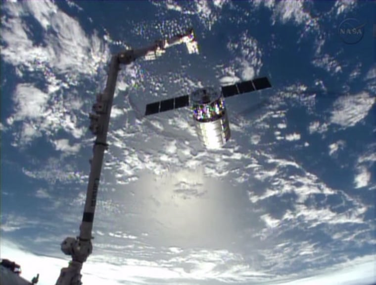 Cygnus cargo craft unhooks from space station