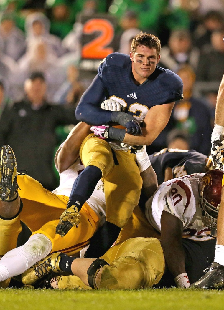 """Despite being in the heat of a nationally-televised football game against USC, Notre Dame running back Cam McDaniel was ready for his close-up, which quickly made him the online meme, """"Ridiculously Photogenic Football Player."""""""