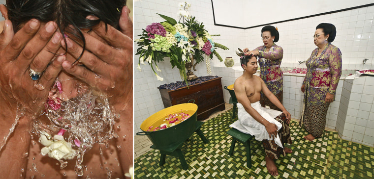 KPH Notonegoro's family joins in to cleanse him as part of the 'Siraman' bathing ritual, done before the formal wedding vows take place.