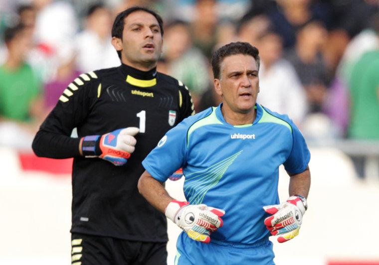 Goalkeeping coach Dan Gaspar, right, with Iran's goalkeeper Rahman Ahmadi.