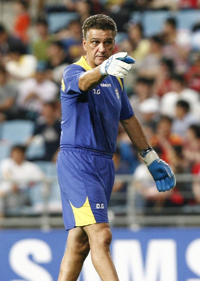 Goalkeeping coach Dan Gaspar leads a pre-game warm-up for the Iran national soccer team.