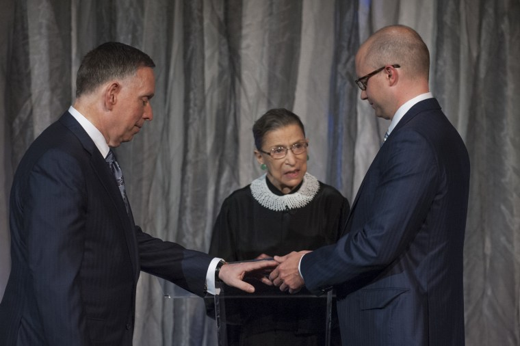 Supreme Court Justice Ruth Bader Ginsburg marries Michael M. Kaiser, left, and John Roberts in a ceremony at the Kennedy Center for the Performing Arts on Saturday. Kaiser is president of the center; Roberts is an economist.