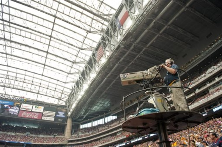 FILE - In this Oct. 2, 2011, file photo, a CBS cameraman works during the second quarter of an NFL football game between the Pittsburgh Steelers and H...