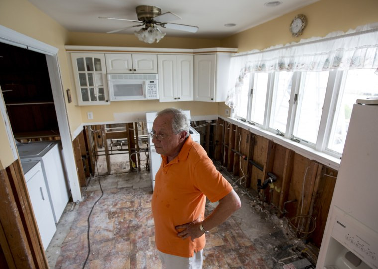 Jack Thompson stands in his Toms River home, which would need to be elevated to comply with new FEMA rules.