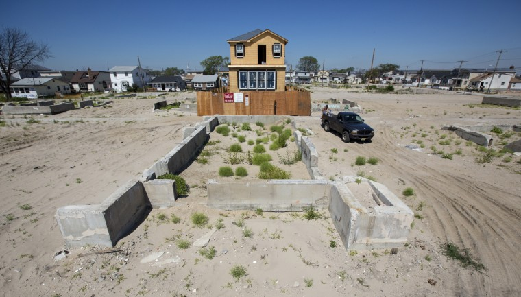 A new home under construction in Breezy Point, N.Y., where property owners are required to elevate their homes or incur drastic hikes to their insurance premiums.
