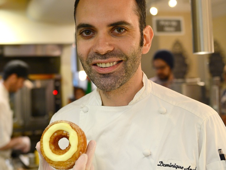 French pastry chef Dominique Ansel poses with a cronut, a croissant-doughnut hybrid, which he created, at his bakery shop in New York, June 14, 2013. ...