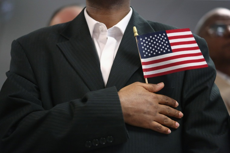A new U.S. citizen recites the pledge of allegiance at a naturalization ceremony on May 17, 2013 in New York City.