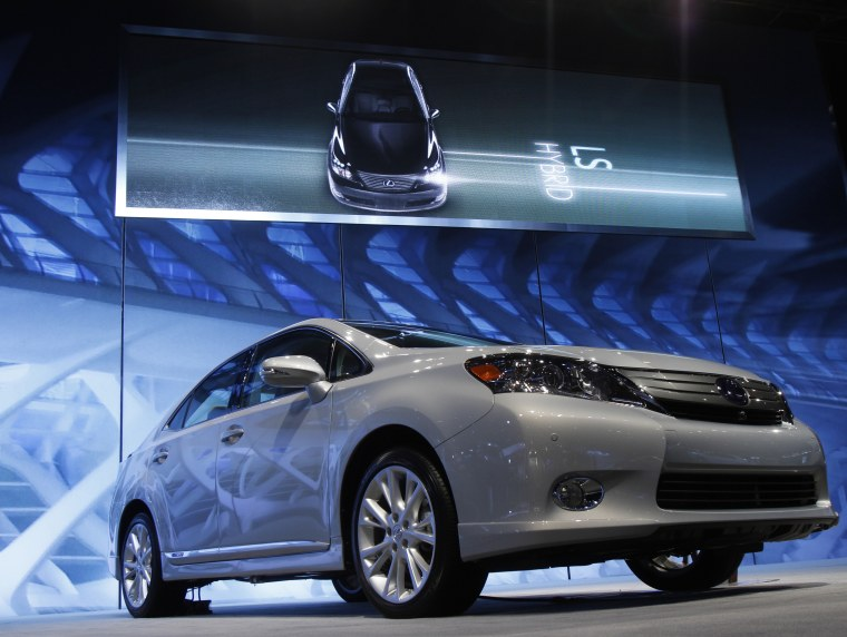 A Lexus HS 250h Hybrid is seen at the Chicago Auto Show February 10, 2010. Toyota will stop production of its Lexus HS250h and Sai hybrids in Japan fr...