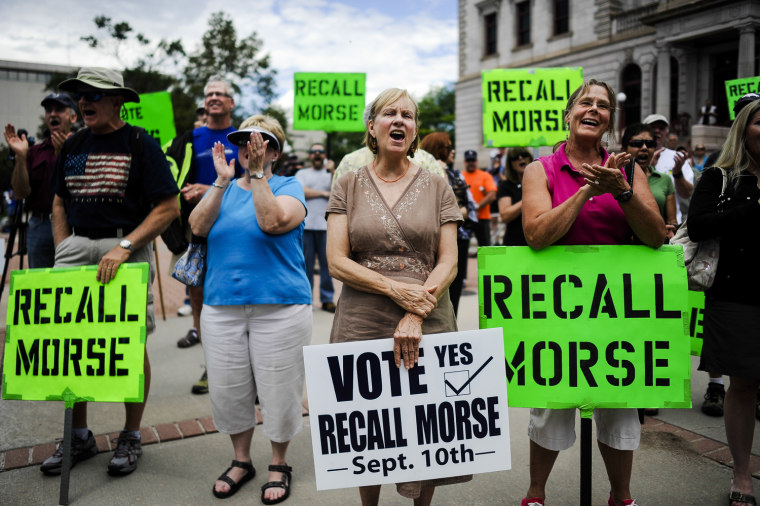 Supporters of the recall election to oust Senate President John Morse rally outside the Pioneer Museum in Colorado Springs, Colo., on Sept. 4.