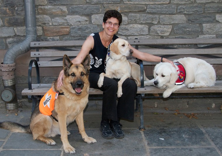 """Image: """"Hero Dogs of 9/11""""; Dr. Cynthia Otto 10 years later with dogs."""