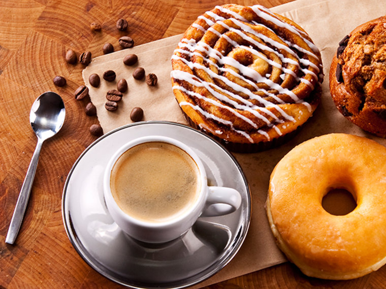 Have the coffee but skip the pastries - a review of the research shows sweet foods may raise the risk of uterine cancer, but coffee lowers it.
