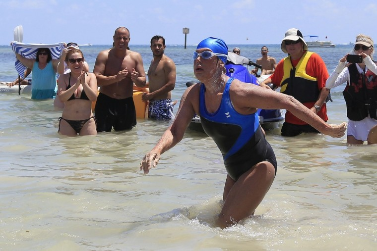 U.S. long-distance swimmer Diana Nyad , 64, walks to dry sand, completing her swim from Cuba as she arrives in Key West, Florida, September 2.