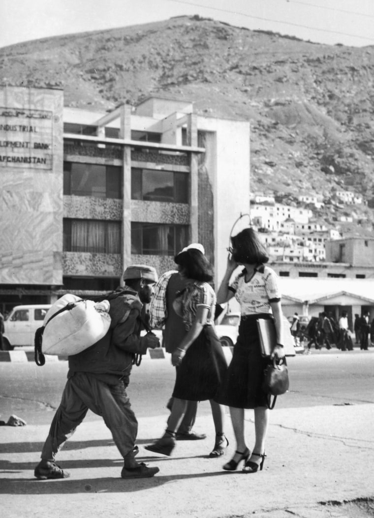 Women in short skirts and high heels walking freely down a street in Kabul in 1978. Before Taliban influence began in the 1990s and extending through today, women had more freedom.