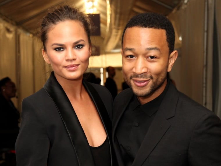 NEW YORK, NY - SEPTEMBER 10:  Model Chrissy Teigen and John Legend pose outside the Samsung Galaxy Lounge at Mercedes-Benz Fashion Week Spring 2014 Co...