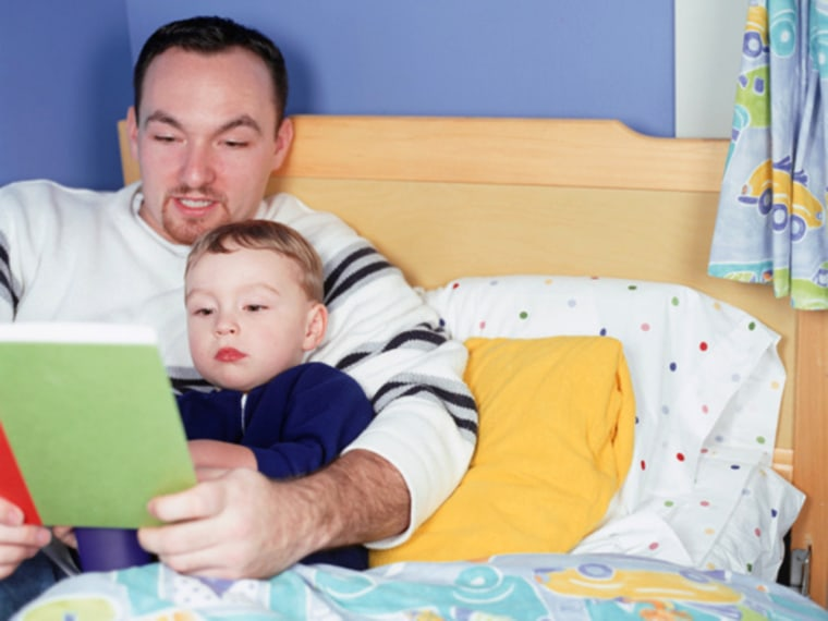 Father reading book to son (4-5) in bedroom; photodisc, stock photo, dad, son, kid, child, parent, bedtime, bed, sleep, tuck in, book, read, story
